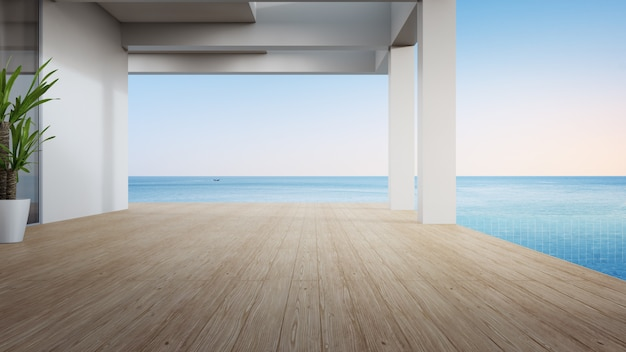 Terraza vacía cerca de la piscina en la casa de playa moderna