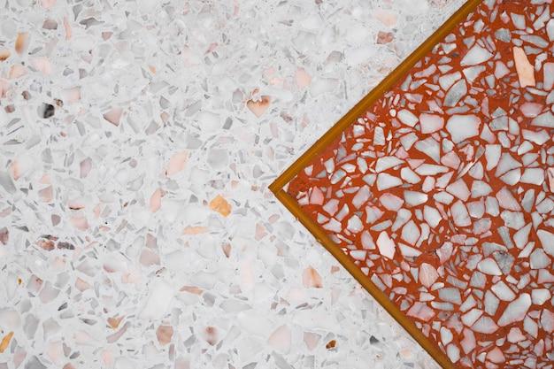 Terrazo pulido piso y pared de piedra.