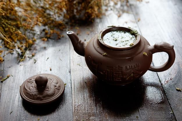 Tetera de arcilla de té verde terapéutico a base de hierbas