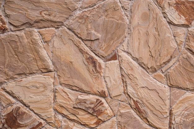 Textura antigua pared de roca hecha de piedra al azar