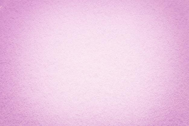 La textura del antiguo fondo de papel rosa claro, primer plano, estructura de cartón denso,