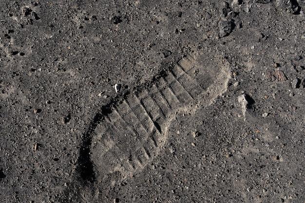 Textura de arena huellas en la arena.