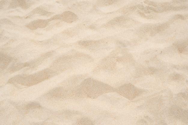 Textura de arena de playa, fondo de arena, naturaleza de arena.