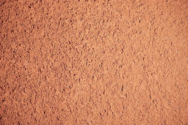 Textura de arena roja del campo de tenis