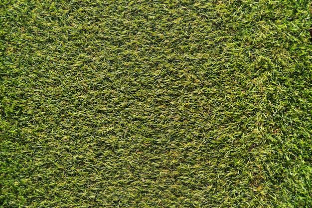 Textura artificial del césped de la hierba. fondo superficial verde.