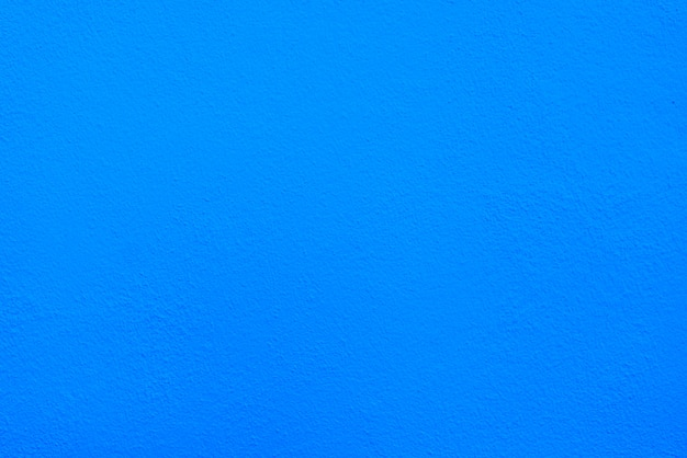 Textura azul del cemento o del muro de cemento para el fondo.