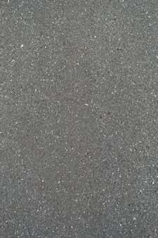 Textura de carretera de asfalto suave de patrón de diseño negro, fondo de vista superior.