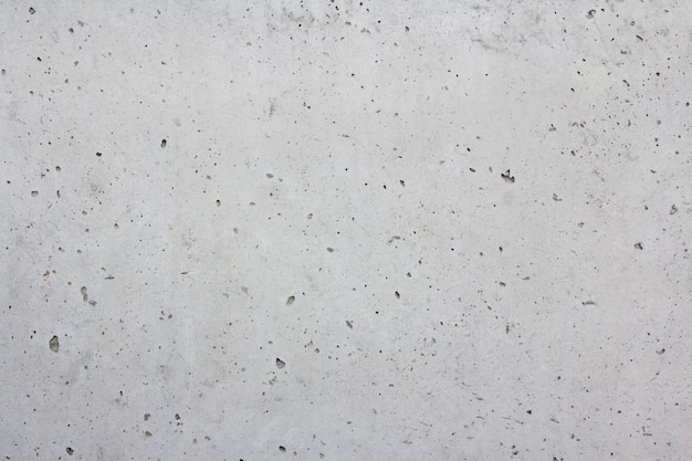 Textura de cemento liso con agujeros. gris. fondo.