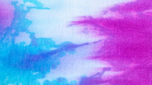 Textura colorida de la tela del teñido anudado