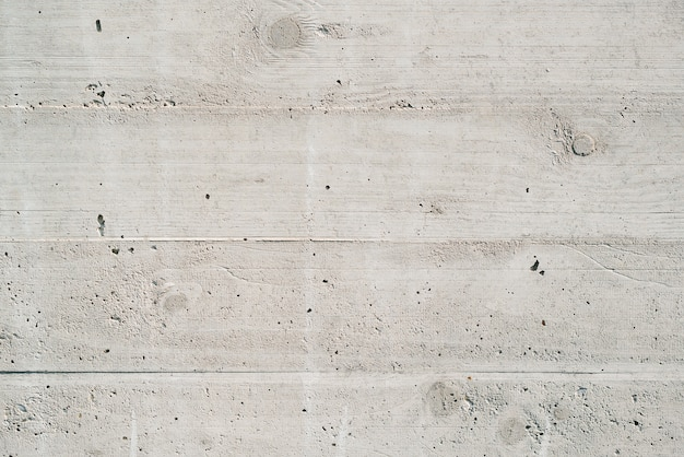 Textura de columnas enlucidas. antiguo muro de hormigón gris.