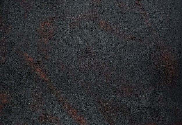 La textura concreta negra aherrumbró fondo abstracto