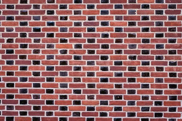 Textura de contraste de pared de ladrillo rojo y marrón oscuro
