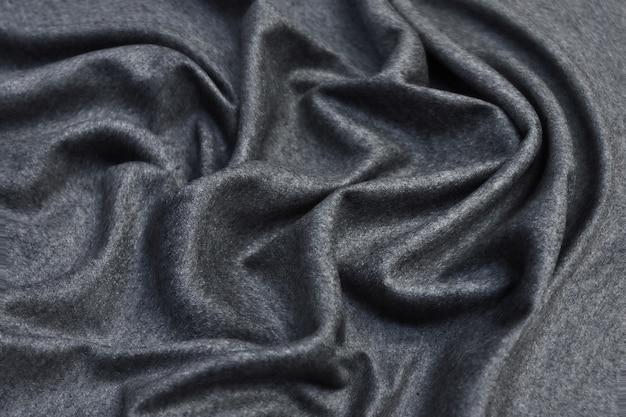Textura de cortinas de géneros de punto gris arrugado