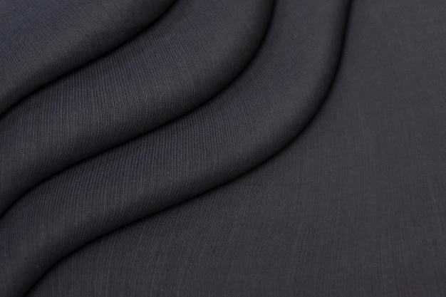 Textura de cortinas de géneros de punto negro arrugado
