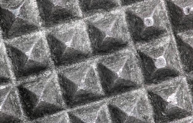 Textura cuadrada abstracta del hierro del metal macro