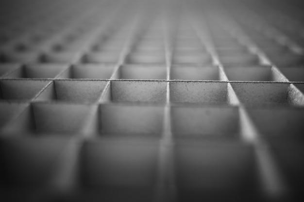 Textura de cuadrícula en blanco y negro en perspectiva de fondo bokeh