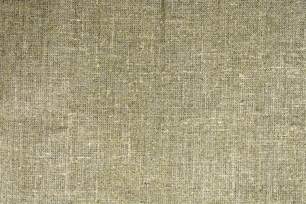 La textura densa de la vieja arpillera, un tejido hecho de lino.