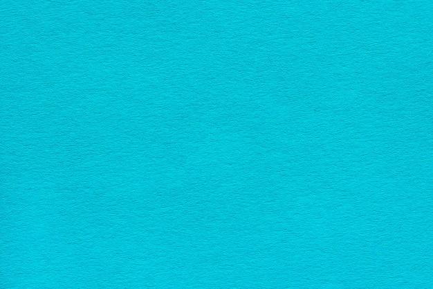 Textura del denso papel azul turquesa.