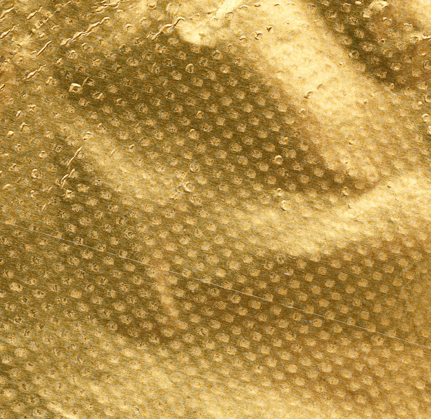 Textura dorada de hoja de papel arrugada, fotograma completo