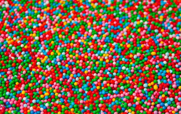 Textura de dulces coloridos pequeños granos pequeños