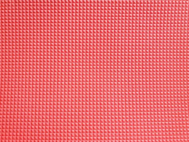 Textura de espuma de polietileno rojo. vista superior