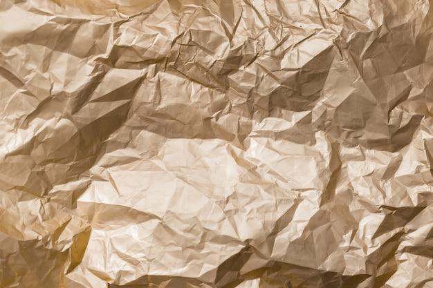 Textura de fondo abstracto dorado brillante hoja de metal arrugada