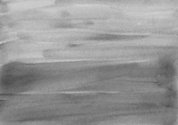 Textura de fondo acuarela negra y gris. trazos de pincel sobre papel.