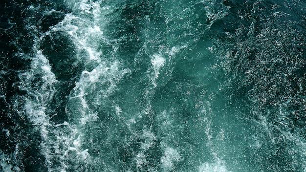 Textura de fondo de agua de onda de cascada azul oscuro abstracto