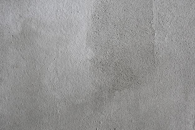Textura fondo áspero pared gris enlucida, superficie irregular tratada con cemento