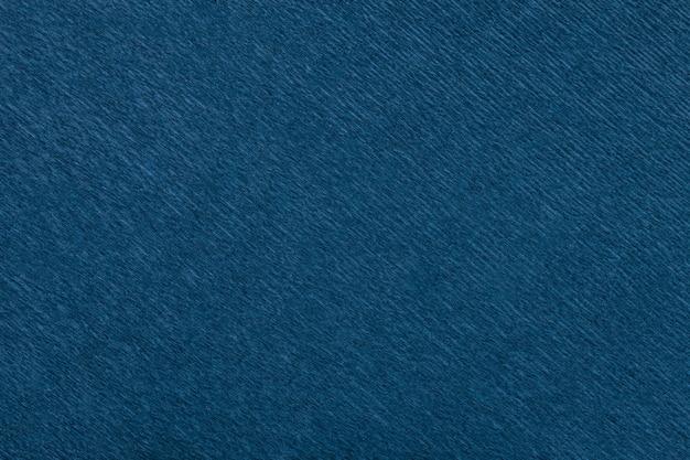 Textura de fondo azul marino de papel ondulado ondulado, primer plano