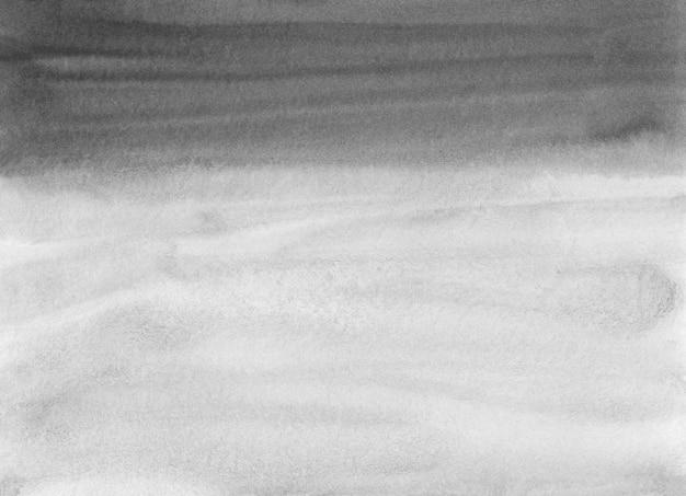 Textura de fondo blanco y negro acuarela. trazos de pincel sobre papel.