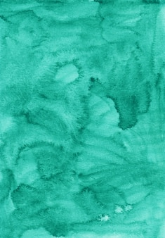 Textura de fondo de color verde marino líquido acuarela. telón de fondo esmeralda aquarelle. manchas sobre papel.
