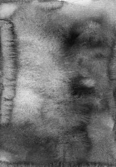Textura de fondo gris oscuro acuarela. manchas monocromáticas sobre papel. pintado a mano