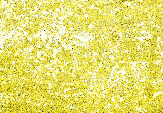 Textura de fondo grunge de muro de piedra de hormigón con pintura descascarada de color amarillo