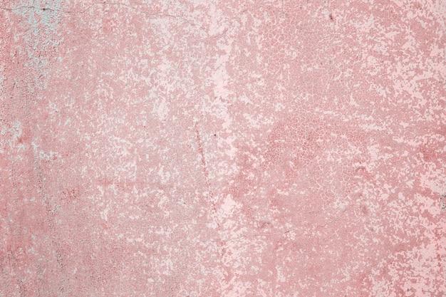 Textura de fondo grunge de muro de piedra de hormigón con pintura descascarada de color rosa