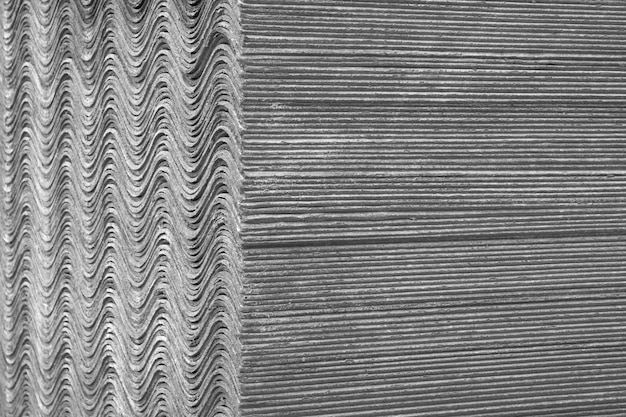 Textura de fondo las hojas de pizarra se encuentran una encima de la otra y forman una superficie recta y ondulada.