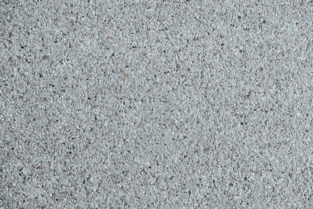Textura de fondo de muro y piso de concreto de acabado agregado explotado.