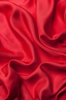 Textura de fondo de ondas de tela roja