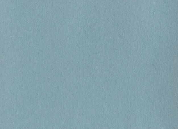 Textura de fondo de papel de cartón kraft azul limpio.