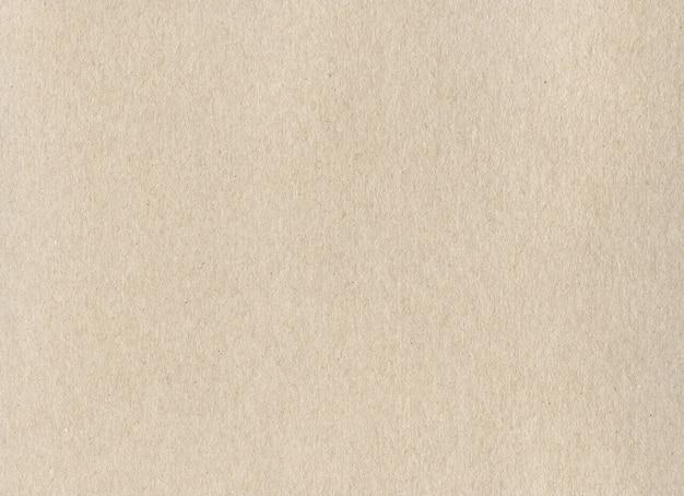Textura de fondo de papel de cartón kraft beige limpio.