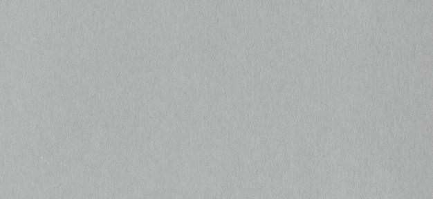 Textura de fondo de papel de cartón kraft gris limpio.
