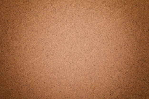 Textura del fondo del papel marrón oscuro de la vendimia con la ilustración mate. estructura de cartón kraft de bronce denso.