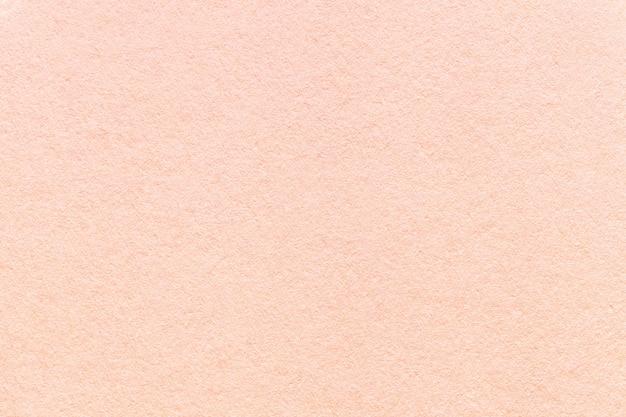 Textura de fondo de papel rosa claro antiguo, estructura de cartón coral denso