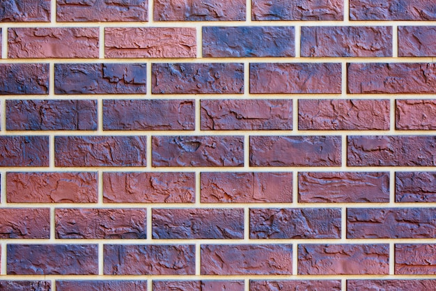 Textura del fondo de la pared de ladrillo coloreada.