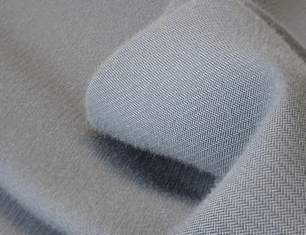 Textura de fondo, patrón. traje de lana de tela gris