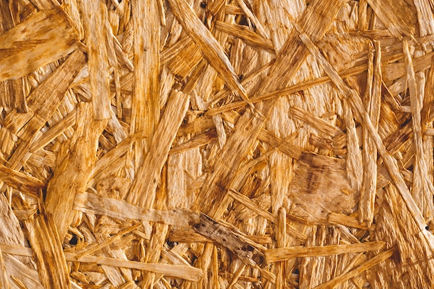 Textura de fondo. superficie del tablero de madera osb. vista superior. copia espacio