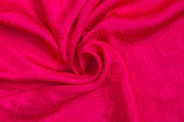 Textura de fondo de tela de raso rosa con corazones. fondo de amor día de san valentín.