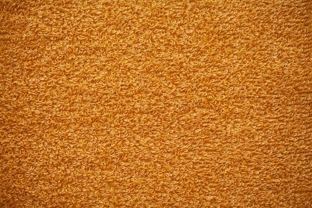 Textura de fondo de toalla de algodón natural de rizo amarillo.