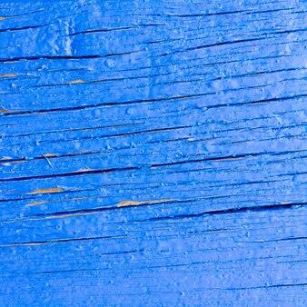 Textura de fondo del viejo tablero azul y grietas