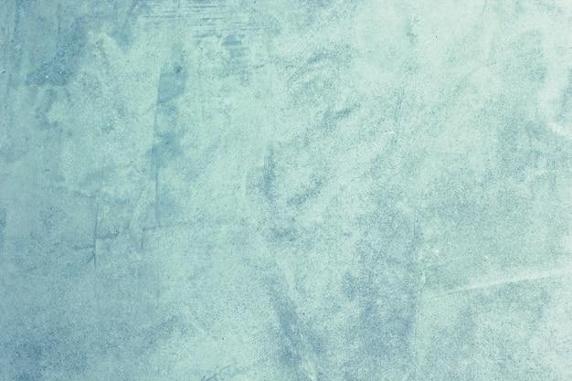 La textura de fondo del yeso de cemento es azul crudo.